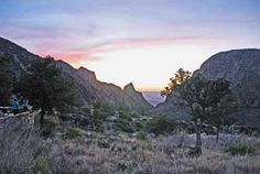 Easy Park Hikes- The Window View Trail at Big Bend National Park | National Parks Traveler - The view of the distant desert through The Window is a fine way to enjoy the sunset at Big Bend. Photo by Jim Burnett.