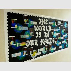 """Earth Day Bulletin Board: coffee filter earth, pictures of each student holding the globe, and a laminated """"Earth Day Pledge"""" (to be used as a book mark when I take down the board)"""