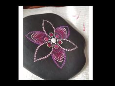 This lovely flower design is very special to me. The stone was lovingly provided by lake erie. I used acrylics from and the brushes are from and Music: chris anton . Acrylic Artwork, Dot Art Painting, Rock Painting Designs, Mandala Painting, Mandala Painted Rocks, Mandala Rocks, Flower Mandala, Sharpie Art, Sharpie Doodles