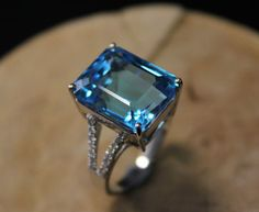 4 Carat Blue Topaz Engagement Ring Diamonds 14K by SteveleeJewelry, $685.00  THIS. THIS is what I want. No if's, and's, or but's about it. I love it!!! Just maybe...tone the carat size down...lol