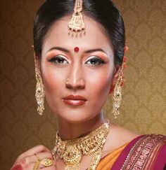 The Ethnic Kannada Bride: Her rich culture is embellished by deep shades of crimson and tones of bronze. Glossy maroon lips and striking thick lashes add to her exotic charm. #BeautifulBrides