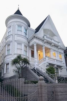 Haight Ashbury Home:: White Victorian Home.  Neat rounded rooms ... at least 3 stories!  Great landscaping & upper porch.
