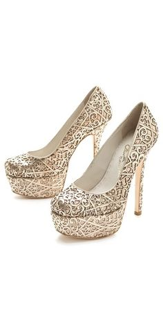 If this wasn't a pair of platforms, I'd like them better.    alice + olivia Larimore Laser Cut Pumps