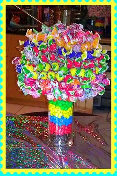 Lolly pop tree Center piece    Hurricane vase from the dollar tree, M&M, 5 inch Styrofoam ball from Michaels and about 145 lolly pops