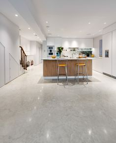 Concrete doesn't have to be grey. This Oyster White Lazenby Polished Concrete floor with its mottled appearance creates a beautiful feature within a beautifully designed kitchen.