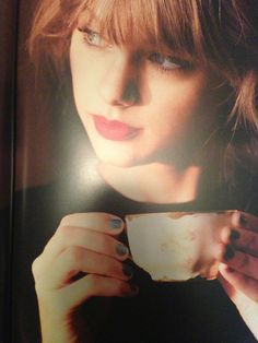 Sipping is the perfect catalyst for sorting one's thoughts.  Pictured:Taylor swift