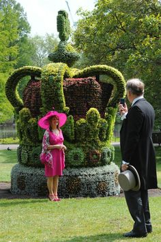 The 13-foot by 8-foot planted floral crown took five weeks to construct, weighs over 11,000 pounds and has the blooms of 13,500 plants.