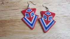 Re, white & blue peyote stitch arrowhead earrings.