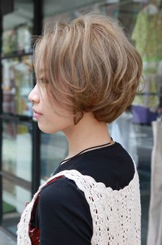 Side View of Cute Short Japanese Curly Hairstyle