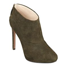 """Simply elegant. That's the only way to describe our Navajoe sky high booties. Navajoe features a foot flattering almond toe design and back zip for easy on/off. Leather or suede upper; simply mouse over your color choice for upper information. Man-made sole. Imported. 1/2"""" hidden platform. 4 1/2"""" stiletto heels.  As seen in the October issue of People Style Watch."""
