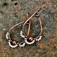 Antiqued copper teardrop hoops were created from heavy gauge copper wire, then wire wrapped in fine copper wire. Along the bottom, petals of