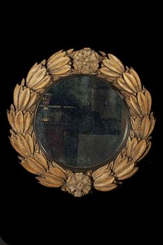 carved pine laurel wreath with tudor roses and a convex mirror - england 1830