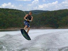 Flying through the air on top of the water! Hot Springs, Lakes, Surfboard, Top, Spa Water, Surfboards, Crop Tee