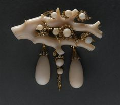 Empire brooch: white coral, diamonds and coral pearls.