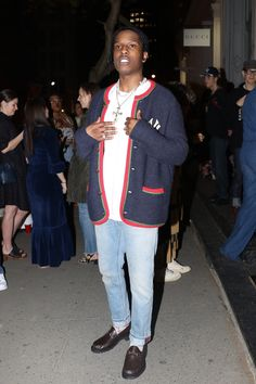 ASAP Rocky wearing Gucci Fall 2018 RTW Yankees Cardigan , Gucci Denim Pant With Web, Gucci Interlocking G cotton socks, Gucci Horsebit Leather Loafer