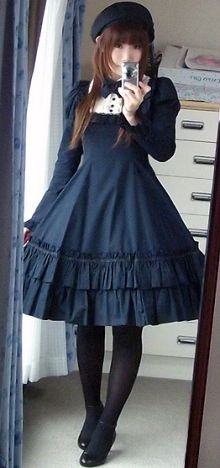 Elegant, classic lolita: Navy dress with frills and white details. Navy bow. Black tights. Black shoes. Black beret.