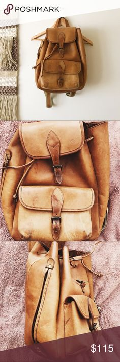 Vintage Brown Leather Rucksack No brand but looks very similar to Madewell's leather rucksack  the material is thick and sturdy material. Medium weight. It's very spacious and comes with a small pouch inside. There's a quick access zipper on the side if you don't want to open from the top. There are water stains and minor scratches but this still has a lot of life left in it. I mainly have just had this in my room as decoration.   Tags. Madewell. Leather. Camel Brown. Vintage. Back pack…