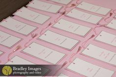 Bookmark escort cards at Lindsey's pink book themed Bat Mitzvah party at DoubleTree Bethesda | Pop Color Events | Adding a Pop of Color to Bar & Bat Mitzvahs in DC, MD & VA | Photo by Bradley Images