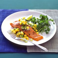 Add flair to simply cooked salmon with toppings like this fresh mango salsa.