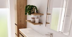 It's vital to consider storage options such as floating shelves to keep toiletries within arm's reach.