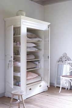 white cabinet with side door