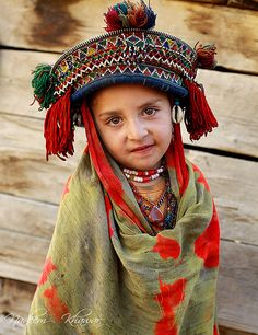 Child from Gilgit, Pakistan       ...Many of the people in this northern region of Pakistan are fair with blue eyes & some have red hair.