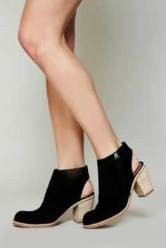 Suede ankle boot with cutout heel and zipper at each inner side. Stacked mid heel. Manmade sole. By Dolce Vita $89.95 by Free People