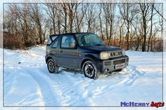 SUZUKI JIMNY deep in the snow.  -- Its good to have 4WD ;)