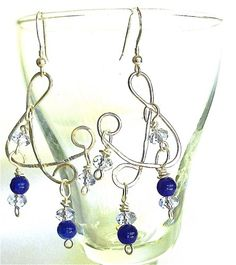 Original design in a free form ampersand symbol in hand hammered silver filled wire hung with Sri Lanka sapphire gemstones and Swarovski crystals. Handmade Jewelry Designs, Swarovski Crystal Earrings, Sapphire Gemstone, Hammered Silver, Photo Jewelry, Designer Earrings, Gemstones, Wire Work, Twists