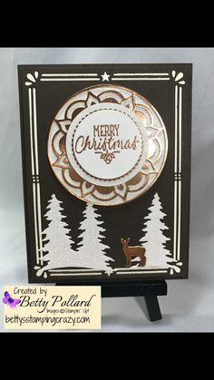 handmade Christmas card ... black with white and gold ... die cuts: Eastern Medallion , trees and frame ... gold embossed sentiment ...