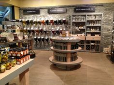 Oil & Vinegar – Olive oil, nut & seed oil, vinegar, gifts and more! Kiosk Design, Retail Design, Store Design, Olive Oil Container, Olive Oil Store, Olive And Vine, Retail Fixtures, Bar Shelves, Spice Shop