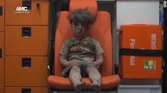 His name is Omran. The image of him, bloodied and covered with dust, sitting silently in an ambulance awaiting help, is another stark reminder of the toll of the war in Syria.