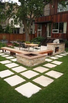 by Chicago Specialty Gardens, Inc.  Chicago, IL, US 60622-5971:  Wicker Park Contemporary  http://www.chicagogardens.com  Pavers set into lawn lend a distinctive modernistic feel to the landscape