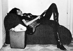 Patti Smith captured sleeping with her guitar.