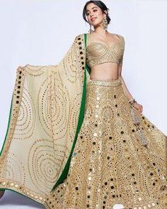 Janhvi Kapoor dazzled in an all gold lehenga choli beautifully hand-crafted with mirrors by Abu Jani & Sandeep Khosla. Gold Lehenga, Lehenga Choli, Anarkali, Bridal Lehenga, Lehenga Wedding, Sarees, Wedding Gowns, Indian Bridal Outfits, Indian Fashion Dresses