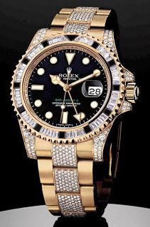 Black and gold Rolex with diamonds.