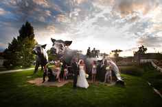 Stunning shot outside the museum with the entire wedding party. Cow and Calf scultpure by Dan Ostermiller