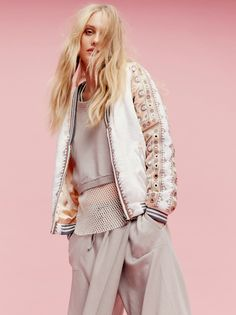 New Romantics Embellished Baseball Jacket | Silky baseball jacket with eye-catching embroidery and decorative mirror accents throughout. One side can be reversed for a more casual, laidback style. Side pockets on both sides. Zip closure. Sporty ribbed waist, cuffs, and collar. Cute
