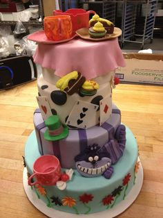Awesome Mad Hatter's tea party cake! Don't know who made it, but I love it.