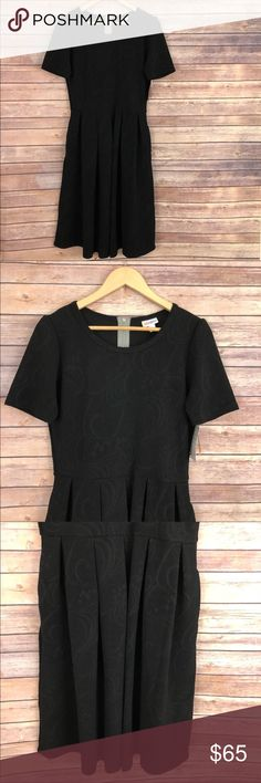 NWT LuLaRoe Solid Black Print Amelia Dress NWT LuLaRoe Solid Black Print Amelia Dress - short sleeves, full skirt, pockets, black with a print throughout, rare and unique combination. Size L - refer to LuLaRoe sizing above. *C* LuLaRoe Dresses Mini