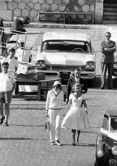"Greta Garbo, a frequent guest on board the Onassis yacht ""Christina,"" leaving the yacht with Tina Onassis, Monaco, 1958"