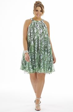 Printed Swing style dress/leaf print Style No: D2157 Printed Chiffon double layer swing dress. This stunning dress has a front and back split overlay feature. This dress is fully lined. #2013 #plussize