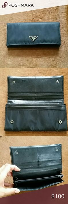 Prada M201 Tessuto Nero Wallet Black nylon. 7.25 x 3.5. 4 card slots. Good used condition. Includes authenticity card & box. Prada Bags Wallets