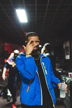 Drake acting funny in a blue Prada sports jacket.
