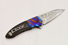 Flipping folding knife.  Blade length: 80mm.  Total length: 197mm.  Blade…