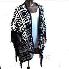 NWT Black & White Plaid Sweater Open Fringe Absolutely beautiful and so soft! Available in sizes small, medium, large and XL. New with attached tags. White tank is not included. ⚡Will not be priced lower. ❌No offers❌ Sweaters Shrugs & Ponchos