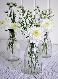 Traditional School Milk Bottle Add blue food coloring to the water and place a single yellow flower in the vase (gerber daisy or sunflower....) can tie twine of a thin ribbon around the neck