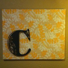"""My """"go to"""" decorating trick: fabric covered canvas. I tacked the letter on and love it even more."""