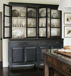 A classic style with a touch of modern. I think I'm just a little smitten by this Atlanta, Geor… A classic style with a touch of modern. I think I'm just a little smitten by this Atlanta, Geor… Dining Room Hutch, Kitchen Hutch, New Kitchen, Kitchen Decor, Kitchen Modern, Dining Rooms, Kitchen Black, Kitchen Ideas, Kitchen Colors
