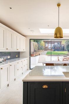 Kitchen Extension We recently designed and fitted this beautiful kitchen in an extension project in south west London. The framed shaker doors are hand painted in Railings and Cornforth White. The brass hardware brings a warmth to the co Kitchen Family Rooms, Kitchen Living, New Kitchen, Kitchen Ideas, Brass Kitchen, Kitchen Reno, West London, White Shaker Kitchen, Shaker Style Kitchens